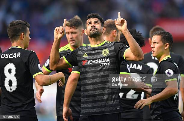 Diego Costa of Chelsea celebrates with team mates as he scores their first goal during the Premier League match between Swansea City and Chelsea at...