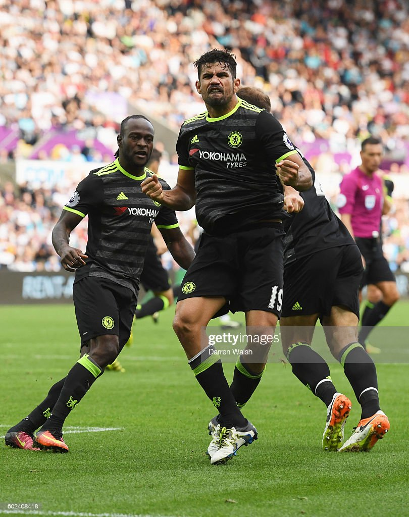 Diego Costa of Chelsea (19) celebrates with team mates Victor Moses and Branislav Ivanovic as he scores their second goal during the Premier League match between Swansea City and Chelsea at Liberty Stadium on September 11, 2016 in Swansea, Wales.