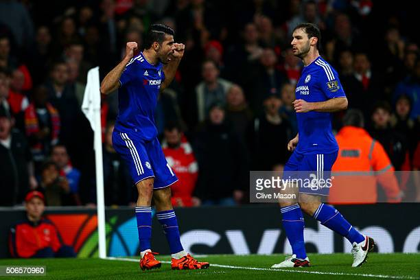 Diego Costa of Chelsea celebrates with teammate Branislav Ivanovic of Chelsea after scoring the opening goal during the Barclays Premier League match...