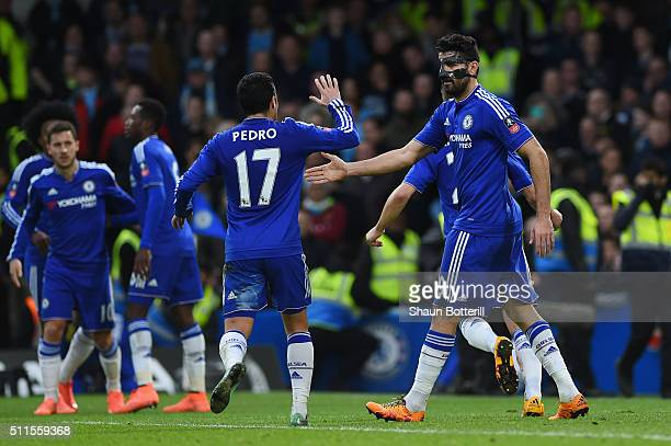 Diego Costa of Chelsea celebrates with teammate Pedro of Chelsea after scoring the opening goal during The Emirates FA Cup fifth round match between...