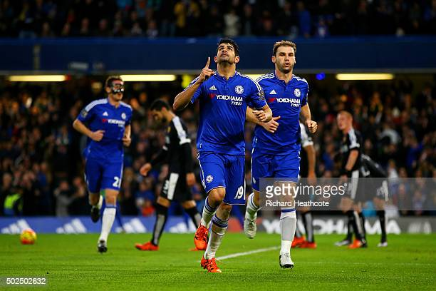 Diego Costa of Chelsea celebrates with teammates after scoring the opening goal during the Barclays Premier League match between Chelsea and Watford...