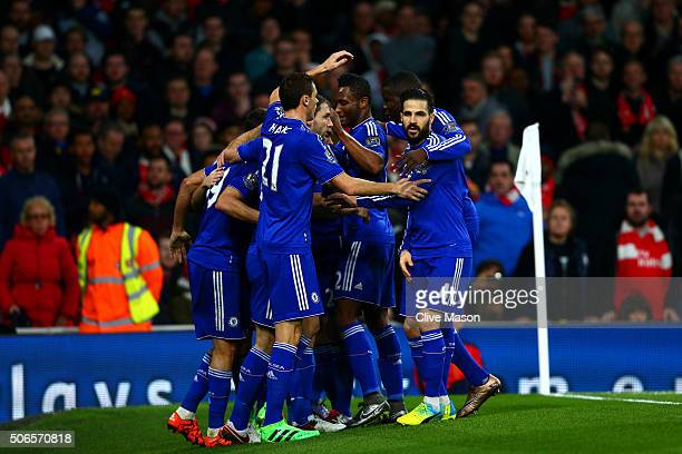 Diego Costa of Chelsea celebrates with teammates after scoring the opening goal during the Barclays Premier League match between Arsenal and Chelsea...