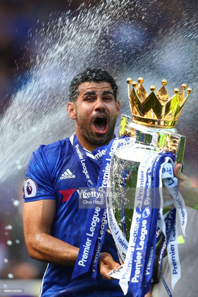 Diego Costa of Chelsea celebrates with the Premier League Trophy after the Premier League match between Chelsea and Sunderland at Stamford Bridge on May 21, 2017 in London, England.