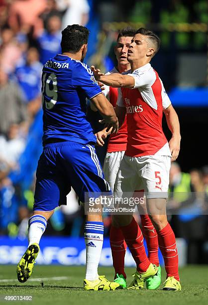 Diego Costa of Chelsea clashes with Gabriel Paulista and Laurent Koscielny of Arsenal during the Barclays Premier League match between Chelsea and...
