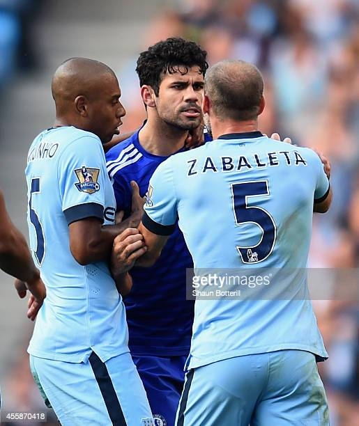 Diego Costa of Chelsea clashes with Pablo Zabaleta of Manchester City prior to the red card during the Barclays Premier League match between...