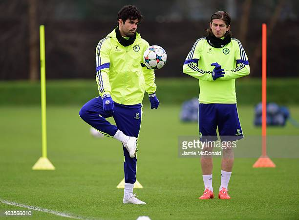 Diego Costa of Chelsea controls the ball as Filipe Luis of Chelsea looks on during a Chelsea training session ahead of the UEFA Champions League...