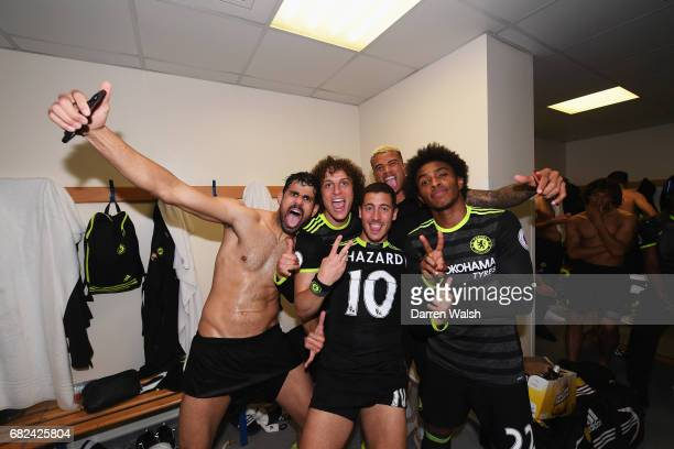 Diego Costa of Chelsea David Luiz of Chelsea Eden Hazard of Chelsea and Willian of Chelsea celebrate winning the league in the changing room after...