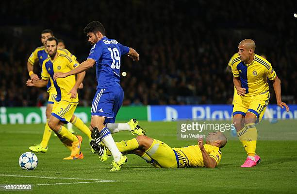 Diego Costa of Chelsea draws a foul in the penalty area from Tal Ben Haim I of Maccabi Tel Aviv during the UEFA Chanmpions League group G match...