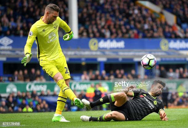 Diego Costa of Chelsea fouls Maarten Stekelenburg of Everton during the Premier League match between Everton and Chelsea at Goodison Park on April 30...