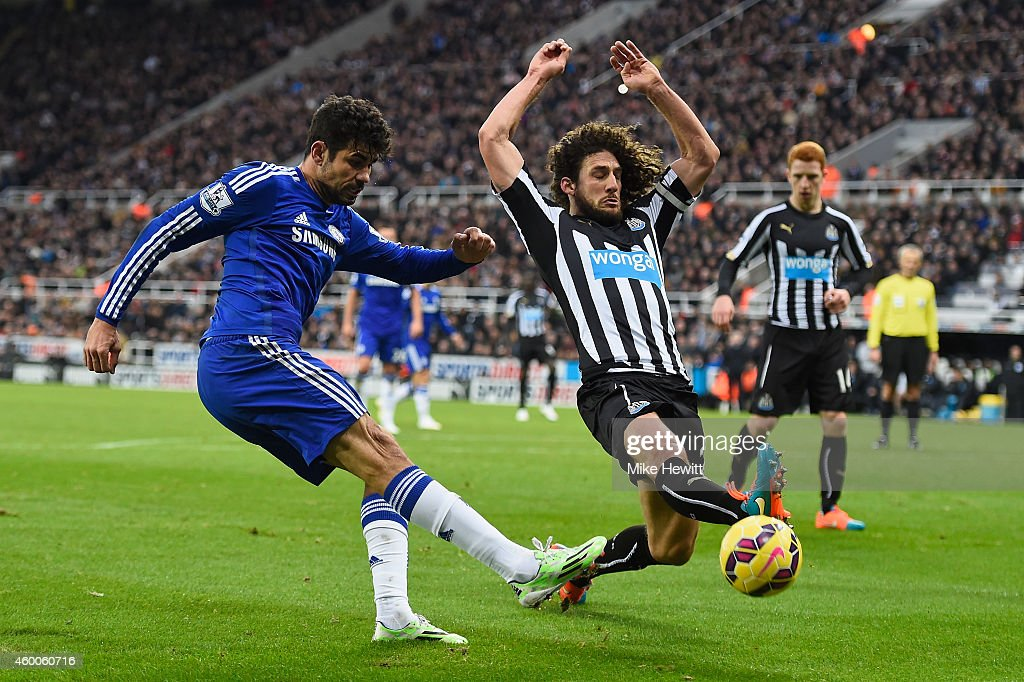Diego Costa of Chelsea gets in a cross despite the efforts of Fabricio Coloccini of Newcastle during the Barclays Premier League match between...