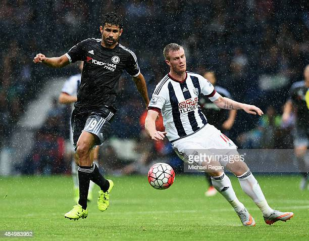 Diego Costa of Chelsea goes past Chris Brunt of West Bromwich Albion during the Barclays Premier League match between West Bromwich Albion and...