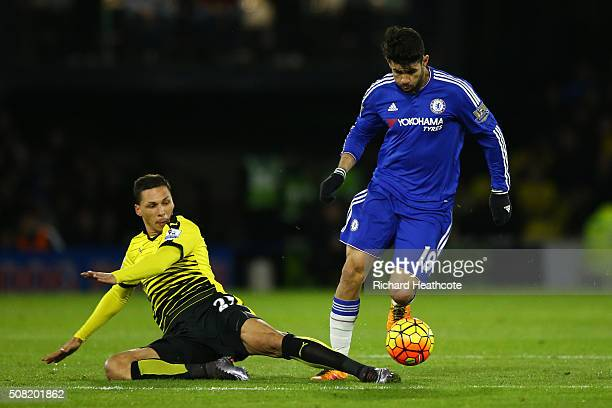 Diego Costa of Chelsea goes past the challenge from Jose Holebas of Watford during the Barclays Premier League match between Watford and Chelsea at...