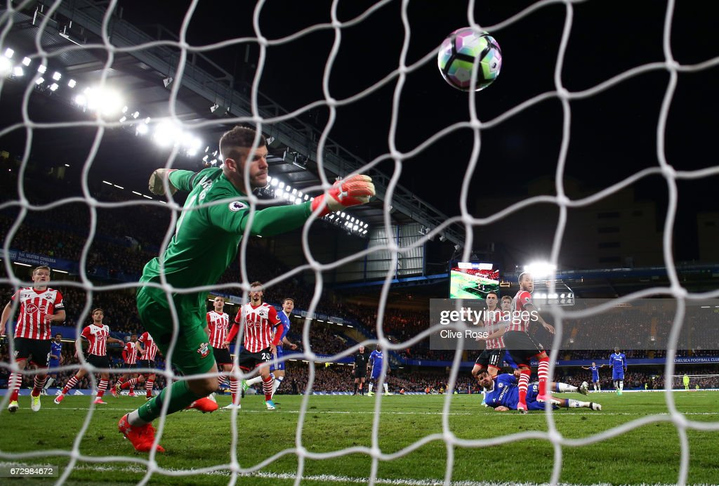 Diego Costa of Chelsea heads past Fraser Forster of Southampton to score their third goal during the Premier League match between Chelsea and Southampton at Stamford Bridge on April 25, 2017 in London, England.