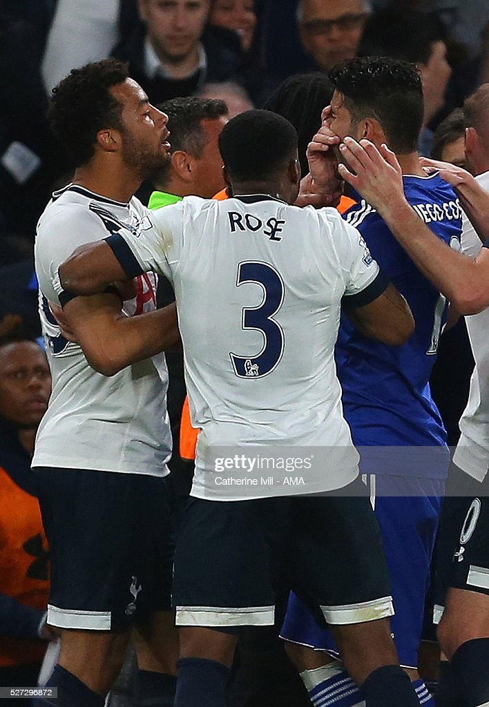 Diego Costa of Chelsea holds his face as he clashes with Mousa Dembele of Tottenham Hotspur during the Barclays Premier League match between Chelsea and Tottenham Hotspur at Stamford Bridge on May 2, 2016 in London, England.