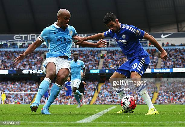 Diego Costa of Chelsea holds off Vincent Kompany of Manchester City during the Barclays Premier League match between Manchester City and Chelsea at...