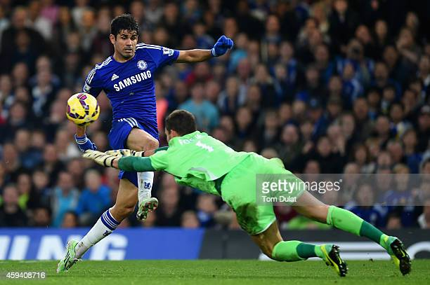 Diego Costa of Chelsea is challenged by Ben Foster of West Brom during the Barclays Premier League match between Chelsea and West Bromwich Albion at...