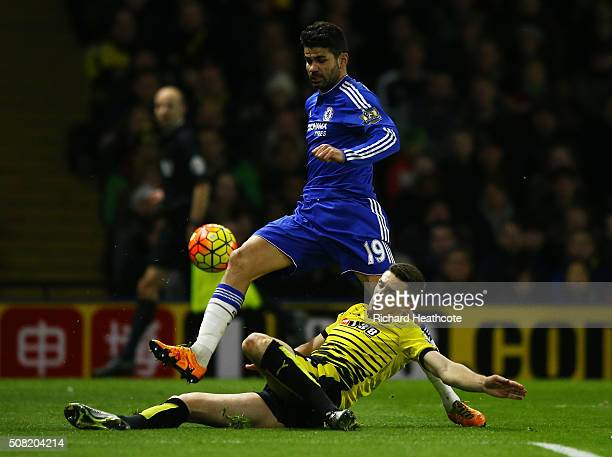 Diego Costa of Chelsea is challenged by Craig Cathcart of Watford during the Barclays Premier League match between Watford and Chelsea at Vicarage...