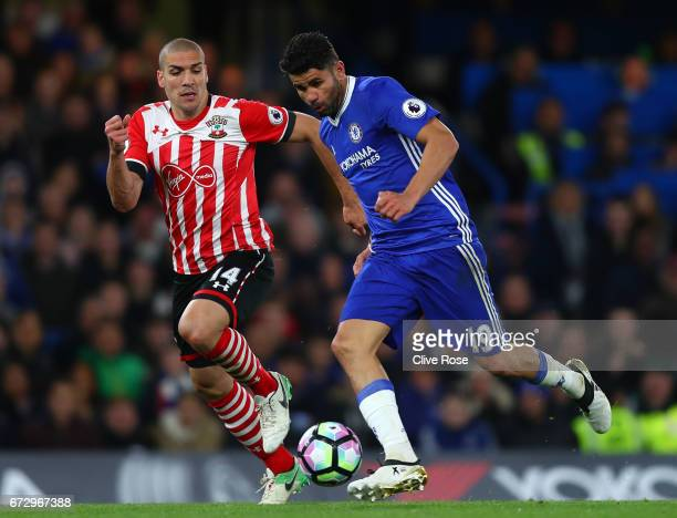 Diego Costa of Chelsea is chased by Oriol Romeu of Southampton during the Premier League match between Chelsea and Southampton at Stamford Bridge on...