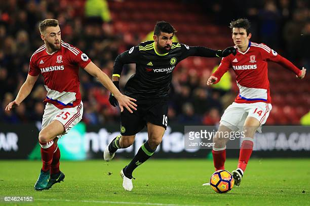 Diego Costa of Chelsea is closed down by Calum Chambers and Marten de Roon of Middlesbrough during the Premier League match between Middlesbrough and...