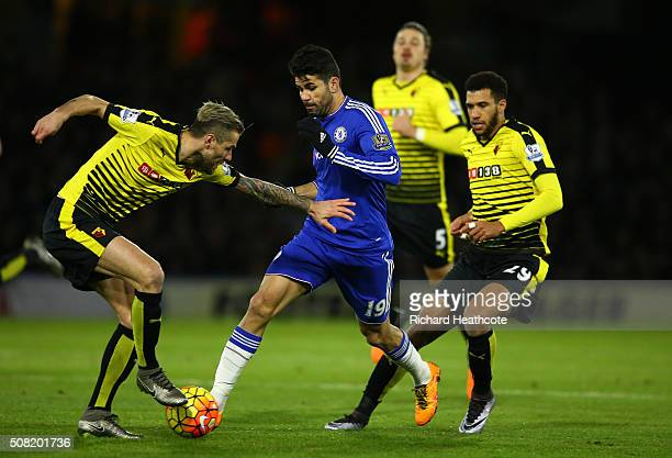 Diego Costa of Chelsea is closed down by Valon Behrami of Watford and Etienne Capoue of Watford during the Barclays Premier League match between...