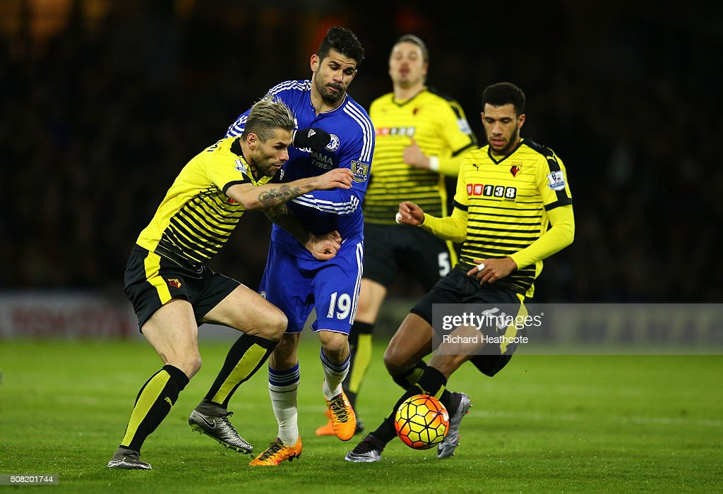 Diego Costa of Chelsea is closed down by Valon Behrami (L) of Watford and Etienne Capoue (R) of Watford during the Barclays Premier League match between Watford and Chelsea at Vicarage Road on February 3, 2016 in Watford, England.