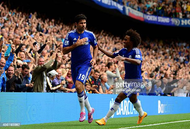 Diego Costa of Chelsea is congratiulated by teammate Willian of Chelsea after scoring his team's second goal during the Barclays Premier League match...