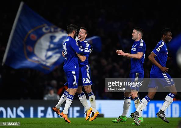 Diego Costa of Chelsea is congratulated by teammates Cesar Azpilicueta and Gary Cahill after scoring a goal to level the scores at 11 during the UEFA...
