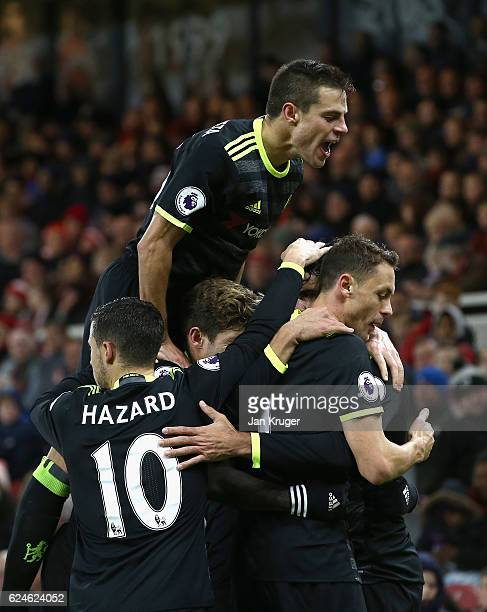 Diego Costa of Chelsea is mobbed by team mates including Cesar Azpilicueta after scoring the opening goal during the Premier League match between...