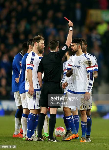 Diego Costa of Chelsea is shown a red card by referee Michael Oliver during the Emirates FA Cup sixth round match between Everton and Chelsea at...