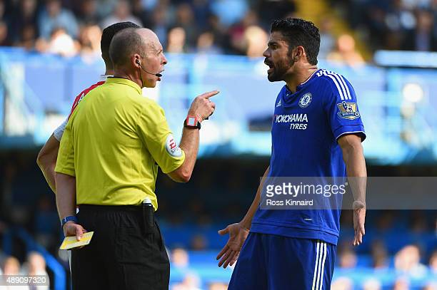 Diego Costa of Chelsea is shown a yellow card by referee Mike Dean during the Barclays Premier League match between Chelsea and Arsenal at Stamford...