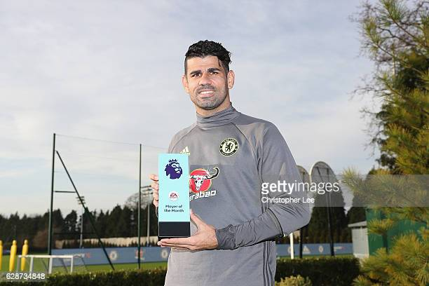 Diego Costa of Chelsea poses with his Player of the Month award as Chelsea receive the Monthly Premier League Awards at Chelsea Training Ground on...