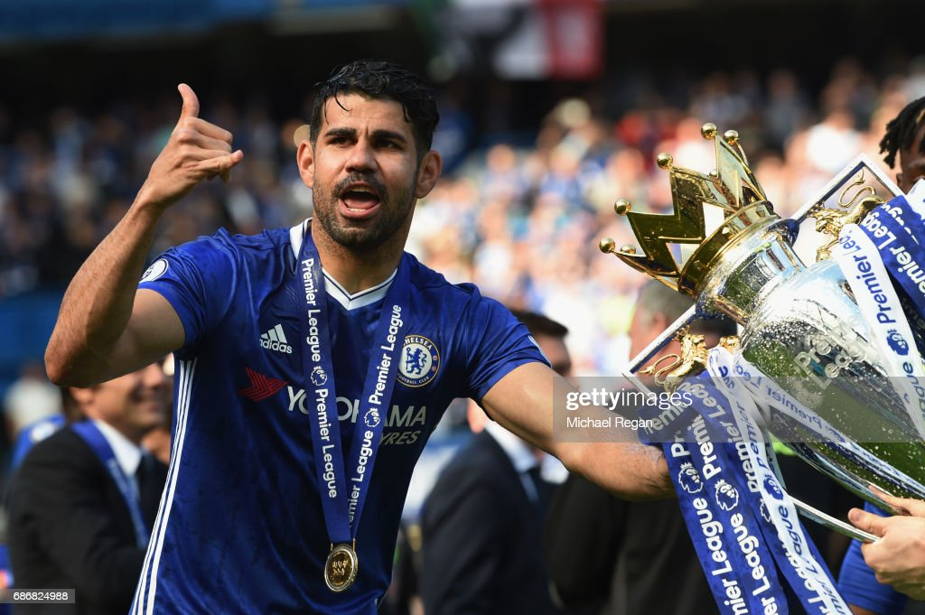 Diego Costa of Chelsea poses with the Premier League Trophy after the Premier League match between Chelsea and Sunderland at Stamford Bridge on May 21, 2017 in London, England.