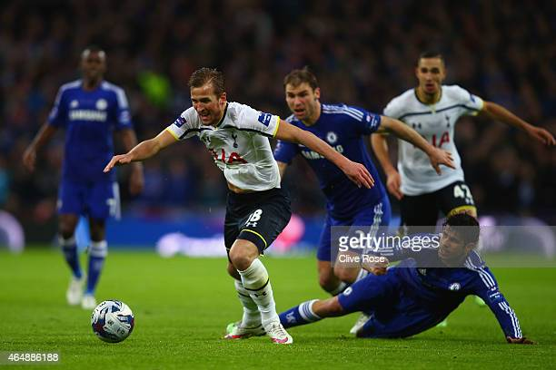 Diego Costa of Chelsea pulls on the shirt of Harry Kane of Spurs during the Capital One Cup Final match between Chelsea and Tottenham Hotspur at...
