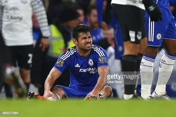 Diego Costa of Chelsea reacts after picking up an injury during the Barclays Premier League match between Chelsea and Everton at Stamford Bridge on...
