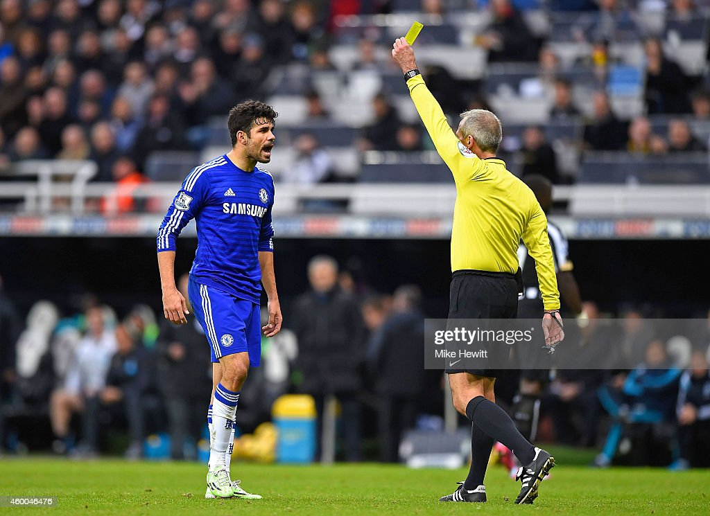Diego Costa of Chelsea reacts as he is shown a yellow card by referee Martin Atkinson during the Barclays Premier League match between Newcastle...