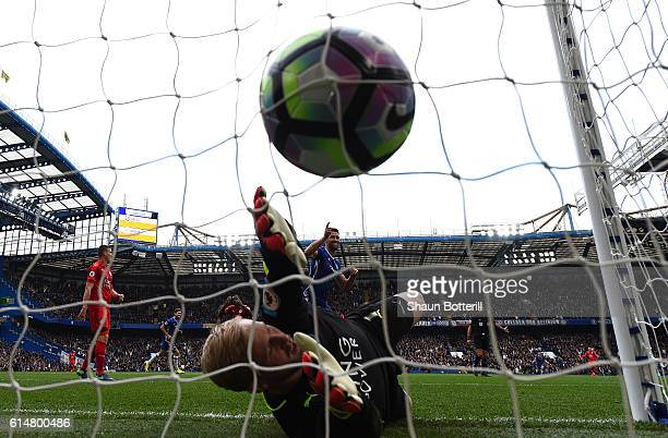 Diego Costa of Chelsea scores his sides first goal past Kasper Schmeichel of Leicester City during the Premier League match between Chelsea and...