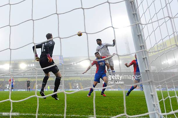 Diego Costa of Chelsea scores his sides first goal with a header during the Premier League match between Crystal Palace and Chelsea at Selhurst Park...