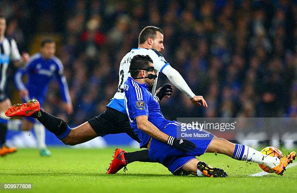 Diego Costa of Chelsea scores his team's first goal during the Barclays Premier League match between Chelsea and Newcastle United at Stamford Bridge...
