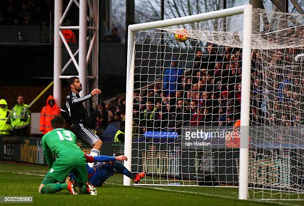 Diego Costa of Chelsea scores his team's third goal during the Barclays Premier League match between Crystal Palace and Chelsea at Selhurst Park on...