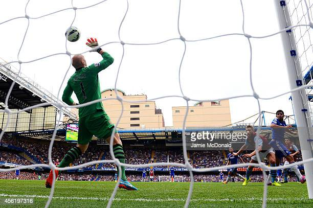 Diego Costa of Chelsea scores his team's third goal past goalkeeper Brad Guzan of Aston Villa during the Barclays Premier League match between...