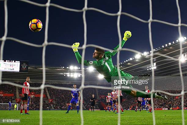 Diego Costa of Chelsea scores past Fraser Forster of Southampton to score his sides second goal during the Premier League match between Southampton...