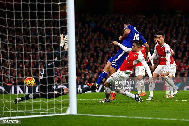 Diego Costa of Chelsea scores the opening goal during the Barclays Premier League match between Arsenal and Chelsea at Emirates Stadium on January 24...