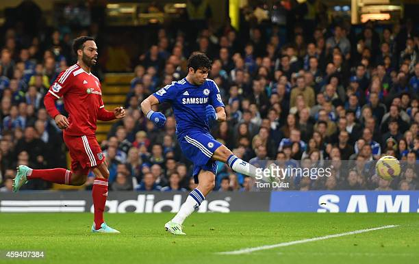 Diego Costa of Chelsea scores the opening goal under pressure from Joleon Lescott of West Brom during the Barclays Premier League match between...