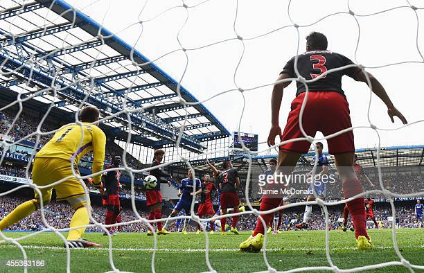 Diego Costa of Chelsea scores their first goal past goalkeeper Lukasz Fabianski of Swansea City during the Barclays Premier League match between...