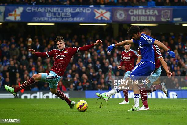 Diego Costa of Chelsea scores their second goal during the Barclays Premier League match between Chelsea and West Ham United at Stamford Bridge on...