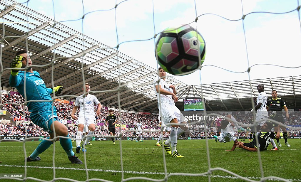 Diego Costa of Chelsea (19) scores their second goal past Lukasz Fabianski and Federico Fernandez of Swansea City during the Premier League match between Swansea City and Chelsea at Liberty Stadium on September 11, 2016 in Swansea, Wales.