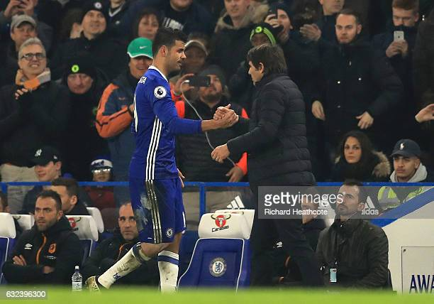 Diego Costa of Chelsea shakes hands with Antonio Conte Manager of Chelsea after substituted during the Premier League match between Chelsea and Hull...