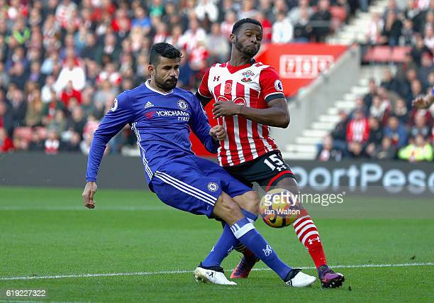 Diego Costa of Chelsea shoots while Cuco Martina of Southampton attempts to block during the Premier League match between Southampton and Chelsea at...