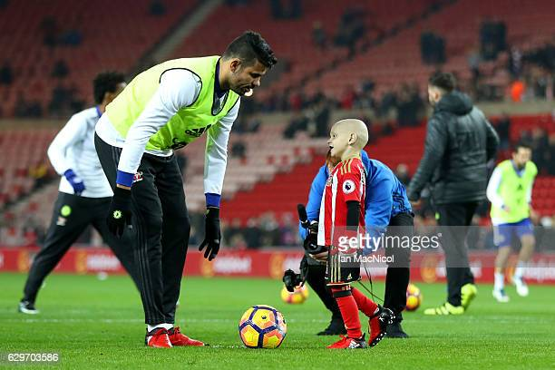 Diego Costa of Chelsea speaks to Bradley Lowrey during the warm up prior to kick off during the Premier League match between Sunderland and Chelsea...