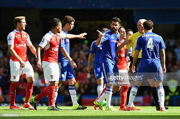 Diego Costa of Chelsea speaks to referee Mike Dean during the Barclays Premier League match between Chelsea and Arsenal at Stamford Bridge on...
